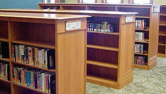 place small individual wood shelving units sidebyside for greater future flexibility in library layout above or larger units can be produced in